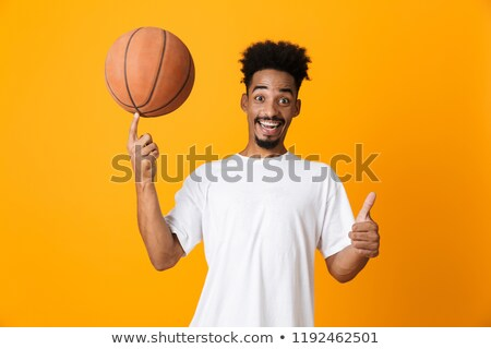 Sorridente moço bola dedo esportes lazer Foto stock © dolgachov
