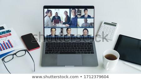 Işkadını video işadamı bakıyor bilgisayar Stok fotoğraf © AndreyPopov