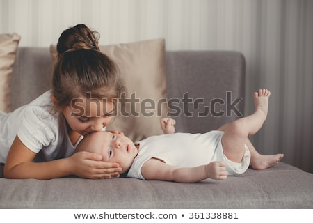 Portrait of brother and sister. Two cute children on bed Stock photo © Lopolo