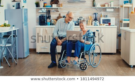 Happy Handicapped Man In Kitchen Stock photo © AndreyPopov