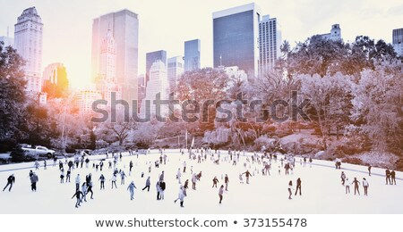 Winter Cityscape and People Skating on Ice Rink Stock photo © robuart