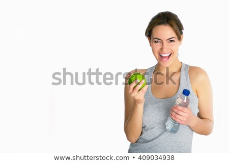 happy sport woman with an apple Stock photo © Lopolo