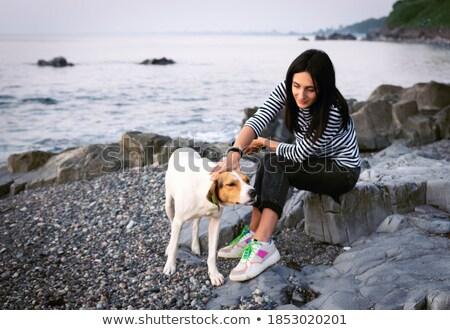 Woman flatters dog. Stock photo © vkstudio