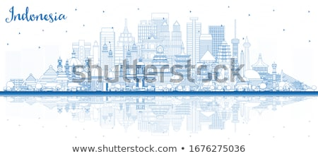 Outline Jakarta skyline with blue buildings and reflections. Stock photo © ShustrikS