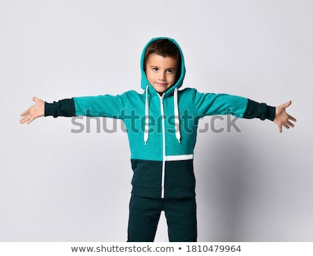 Image of young sportsman wearing tracksuit standing with arms cr Stock photo © deandrobot