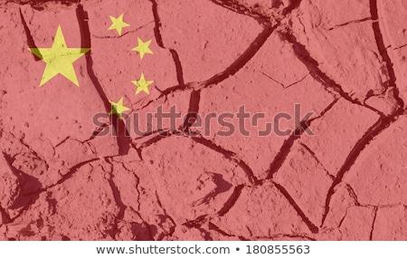 China flag on dry cracked earth Stock photo © olira