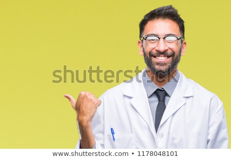 Doctor pointing up. Side portrait with copy space Stock photo © Giulio_Fornasar