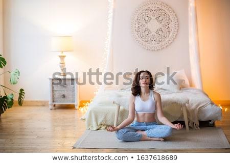 Fiatal barna hajú nő pizsama gyakorol jóga Stock fotó © dashapetrenko