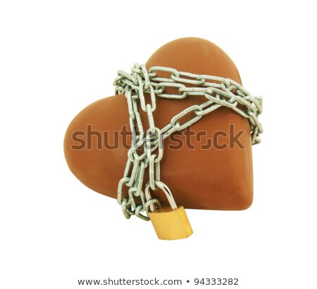 Heart shaped chocolate tied up with chains Stock photo © AndreyKr
