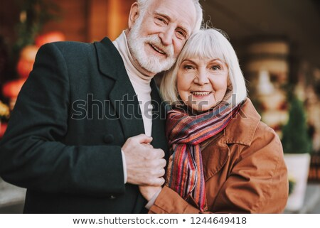 mature gentleman looking at his lady fondly Stock photo © photography33