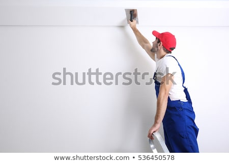 Decorator sanding a plaster ceiling Stock photo © photography33