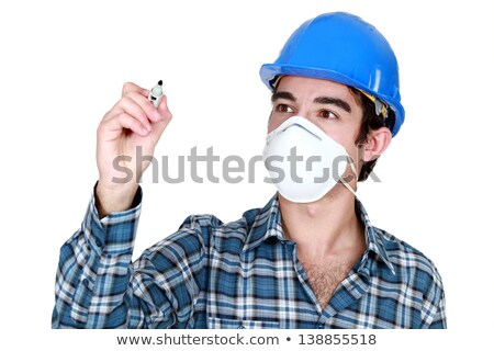 Worker wearing a face mask and holding a felt-tip pen Stock photo © photography33