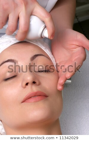Woman getting extra hydration procedure Stock photo © stockyimages