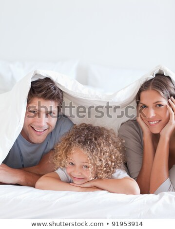Woman laughing under a duvet Stock photo © photography33