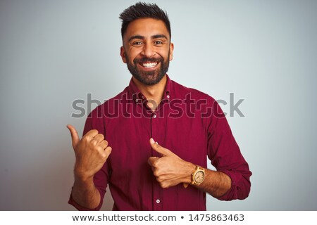 young man presenting in the back stock photo © feedough