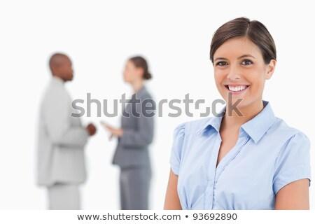 Glimlachend verkoopster praten collega's achter witte Stockfoto © wavebreak_media