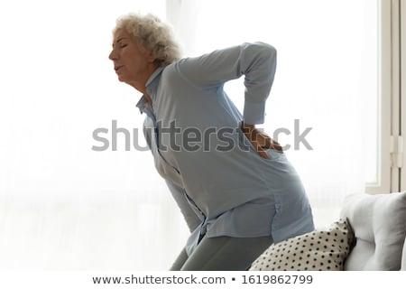 Mulher sentimento dor nas costas mulher jovem nu saúde Foto stock © paolopagani