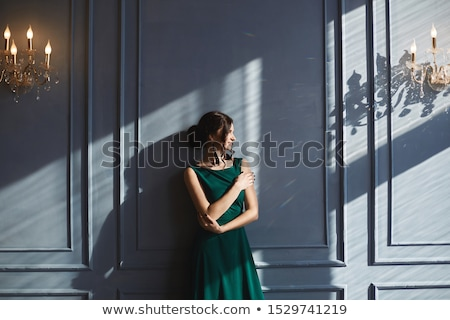 Beautiful woman in blue  dress in luxury interior. Stock photo © Pilgrimego