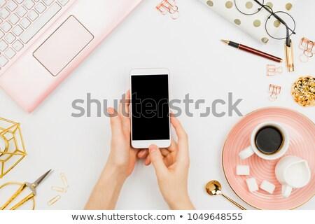 Woman's hand holding a white sugar cube Stock photo © erierika