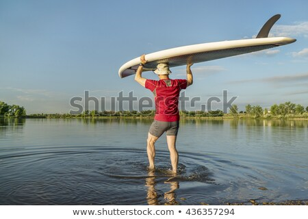 Stock photo: launching stand up paddleboard