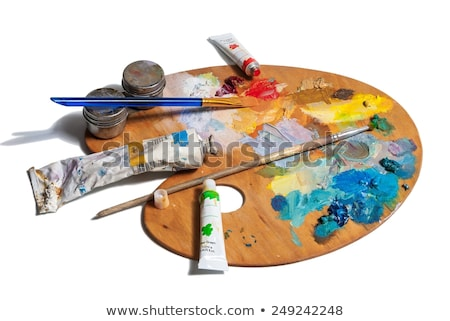 wooden palette with color paints and brush isolated on white bac Stock photo © tetkoren