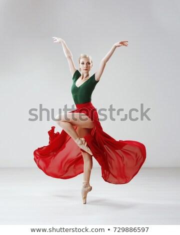 The beautiful ballerina posing in long white skirt  stock photo © master1305