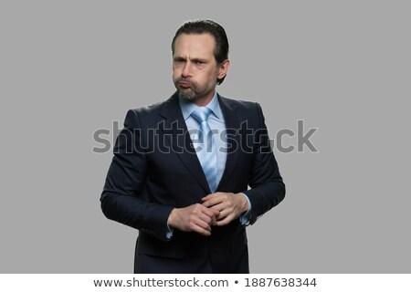 Businessman with inflated cheeks Stock photo © cherezoff
