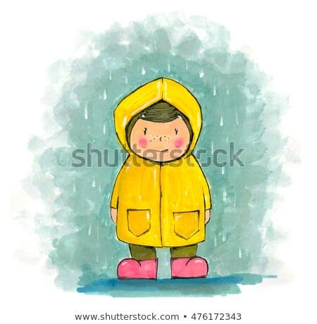 The boy with an umbrella standing under a rain  Stock photo © zurijeta