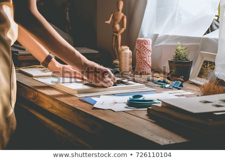 Woman artist drawing at the table in workshop  Stock photo © deandrobot