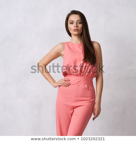A girl wearing a pink sleeveless dress Stock photo © bluering