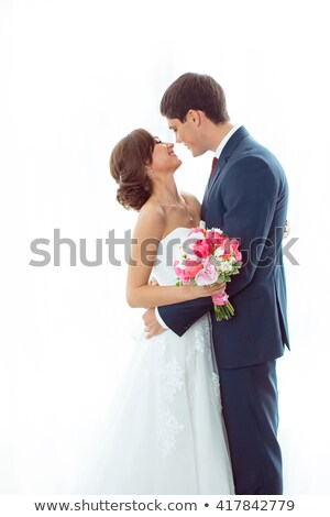 Portrait of beautiful bride standing by window at home Stock photo © wavebreak_media