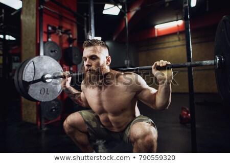 Shirtless man crouching Stock photo © wavebreak_media