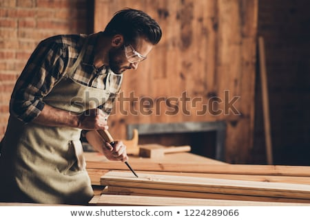 portrait of a serious young male builder stock photo © deandrobot