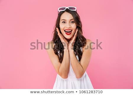 удивленный молодые азиатских женщину глядя камеры Сток-фото © deandrobot