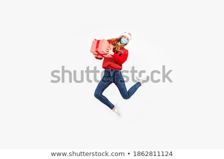 Santa jumps out of a box as a surprise Stock photo © Ustofre9