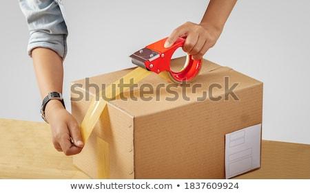 Raktár munkás csomagol csomag szalag üzlet Stock fotó © dolgachov