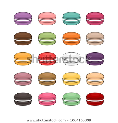dessert cake macaron or macaroon with raspberry and blueberry on stone kitchen table background to stock photo © denismart
