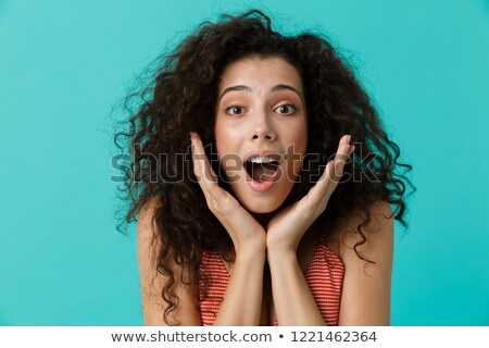 Image of surprised woman 20s wearing casual clothing shouting, s Stock photo © deandrobot