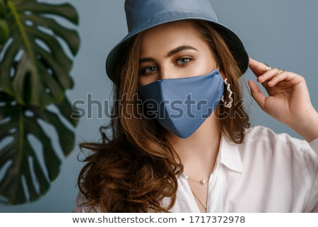 close up of beautiful woman face with earring Stock photo © dolgachov