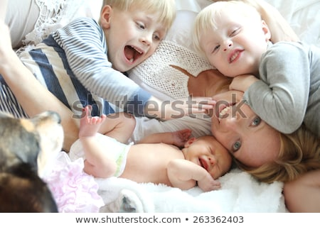 Happy family with four kids and one dog Stock photo © colematt
