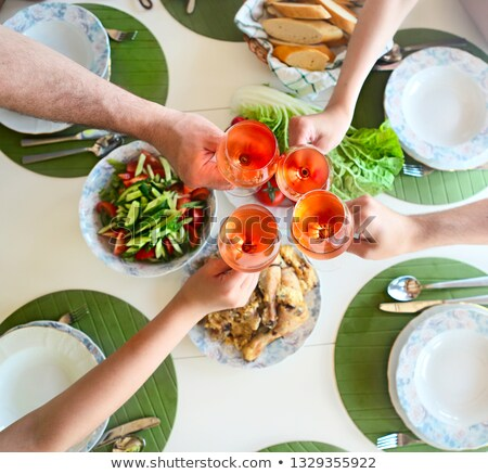 Table with rose wine, fish soup, salad and chiken Stock photo © dashapetrenko
