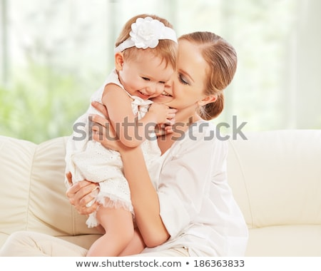 happy family. Mother and baby daughter plays, on the sofa Stock photo © Lopolo