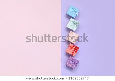 White box with violet ribbon Stock photo © creatOR76