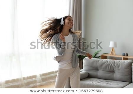 tiener · meisje · genieten · muziek · geïsoleerd · witte - stockfoto © dolgachov