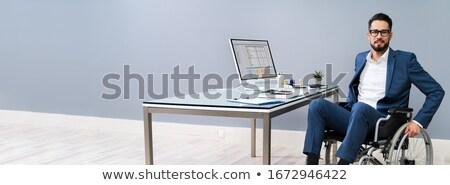 бизнесмен · коляске · компьютер · столе · служба · счастливым - Сток-фото © AndreyPopov