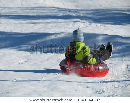Child having fun on snow tube. Boy is riding a tubing. Winter fun for children BANNER, LONG FORMAT Stock photo © galitskaya