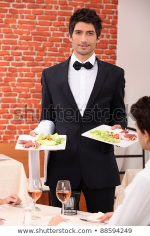 Waiter delivering meals to table Stock photo © photography33