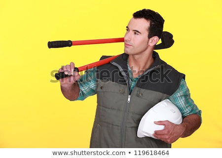 Confident manual worker holding hard hat and bolt cutter Stock photo © photography33