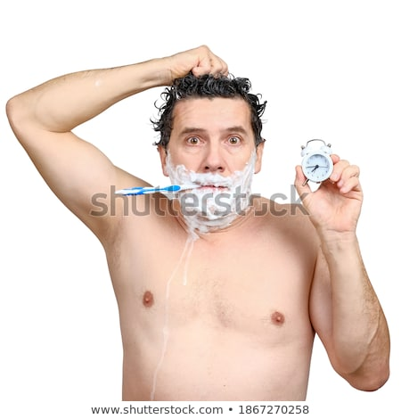 Man in shock at his alarm clock Stock photo © photography33