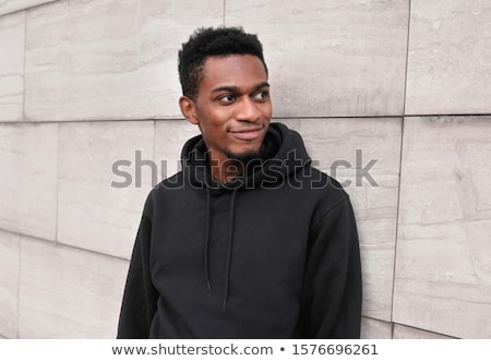 trendy young guy posing in style stock photo © stockyimages